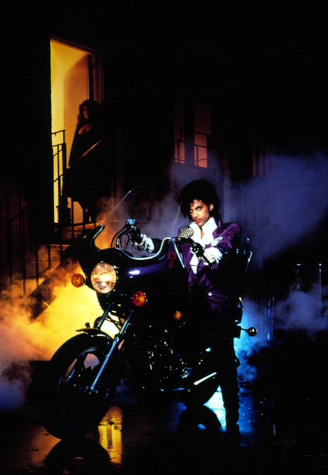 """<p><i>Purple Rain'</i>s soundtrack <a href=""""http://www.imdb.com/title/tt0087957/awards?ref_=tt_awd"""">proved to be just as iconic as the film itself</a>, winning Prince an Oscar in 1985 for Best Original Song Score, Best Soundtrack at the Brit awards, and a Grammy forBest Album Written for a Motion Picture or a Television Special. But besides the music, this image of Prince perched on a motorcycle in all his purple glory will remain forever etched in our memories. The look, which included a pair of pants with an asymmetric fly, a ruffled white shirt, and a long purple coat with chain mail on one shoulder, <a href=""""http://www.mnhs.org/collections/mplsmusic/featured_objects/princes_costume.php"""">was created byLouis Well and Terry Vaughn</a>, who also designed costumes for Earth, Wind and Fire.</p><p><i><i>(Photo: Getty)</i></i></p>"""