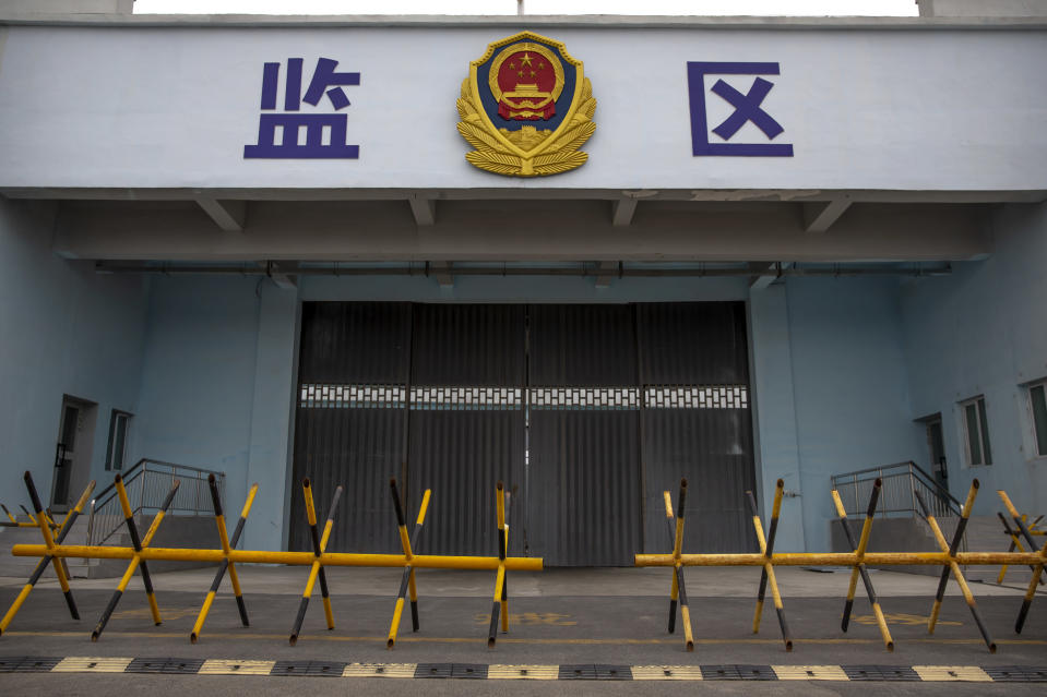 Barricades stand in front of a vehicle entrance to the inmate detention area at the Urumqi No. 3 Detention Center in Dabancheng in western China's Xinjiang Uyghur Autonomous Region on April 23, 2021. Urumqi No. 3, China's largest detention center, is twice the size of Vatican City and has room for at least 10,000 inmates. (AP Photo/Mark Schiefelbein)