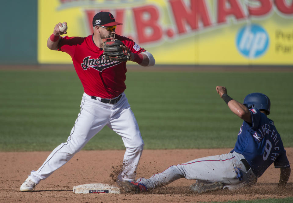 Cleveland Indians' Jason Kipnis forces Texas Rangers' Isiah Kiner-Falefa at second base and throws to first to get Jeff Mathis out and complete a double play during the sixth inning of the second game of a baseball doubleheader in Cleveland, Wednesday, Aug. 7, 2019. (AP Photo/Phil Long)