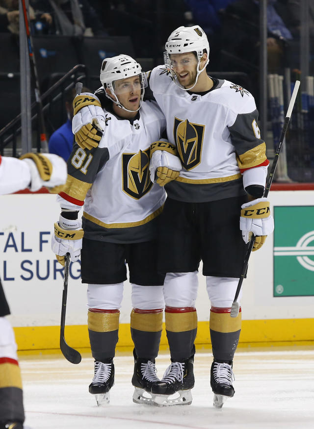 Vegas Golden Knights' Jonathan Marchessault (81) celebrates with defenseman Colin Miller (6) after scoring a goal against the New York Islanders during the first period of an NHL hockey game, Wednesday, Dec.12, 2018, in New York. (AP Photo/Noah K. Murray)
