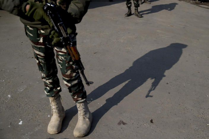 A shadow of an Indian paramilitary soldier is cast as he stands guard at a temporary checkpoint during a strike in Srinagar, Indian controlled Kashmir, Sunday, Feb. 3, 2019. India's prime minster is in disputed Kashmir for a daylong visit Sunday to review development work as separatists fighting Indian rule called for a shutdown in the Himalayan region. (AP Photo/Dar Yasin)