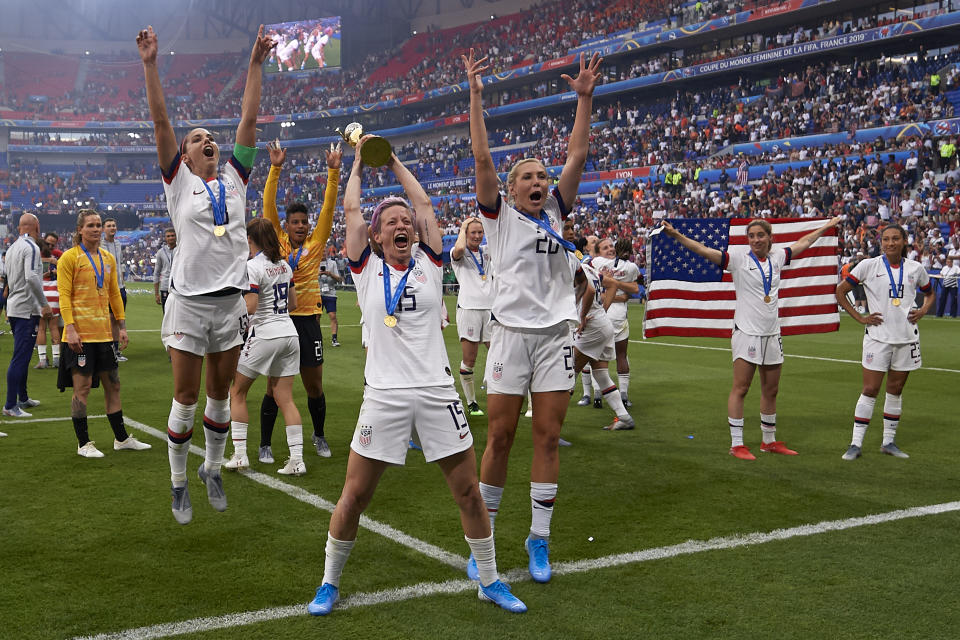 Megan Rapinoe (Reign FC) and Alex Morgan (Orlando Pride) of United States celebrate whit her teammates after winning the 2019 FIFA Women's World Cup France Final match between The United State of America and The Netherlands at Stade de Lyon on July 7, 2019 in Lyon, France. (Photo by Jose Breton/NurPhoto via Getty Images)