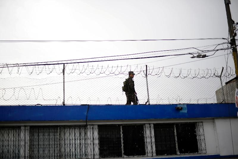 A soldier guards the correctional centre for minors, 'Las Gaviotas', in Guatemala City on July 7, 2015