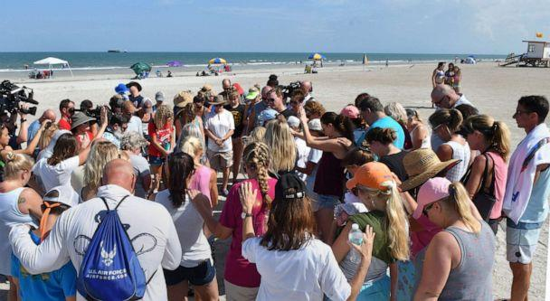 PHOTO: A group of supporters gathered with Stephanie Young McCluney, wife of Brian McCluney, one of two missing boaters, at Jetty Park, Port Canaveral, Fla., Aug. 18, 2019, to pray and search the shore for clues. (Tim Shortt/Florida Today via Imagn)