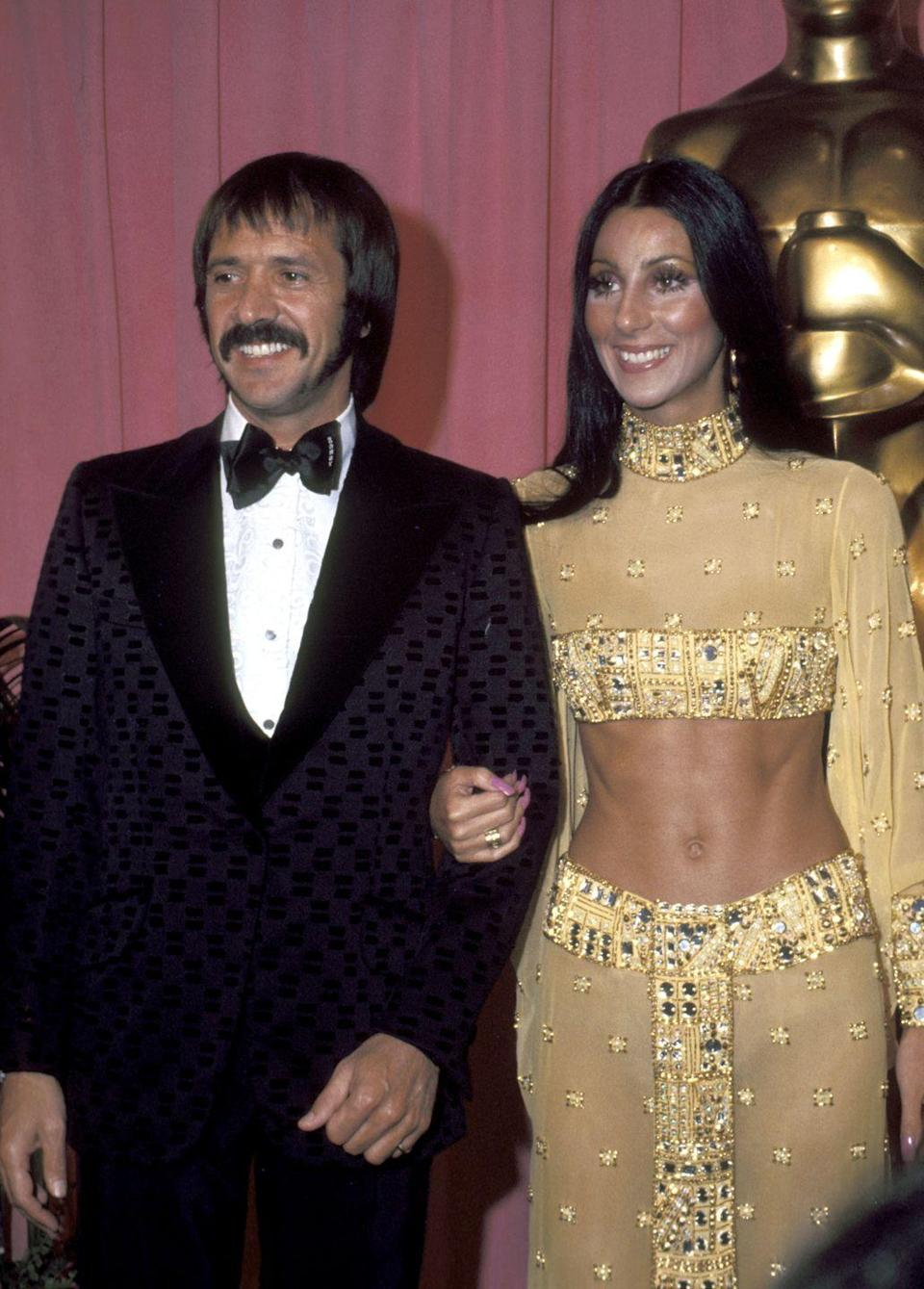 <p>This look just embodies everything Cher: a gold Bob Mackie number, pink stiletto nails, gold hoops and an ab-baring crop top. Even though she wasn't nominated that year, she still stole the show. </p>