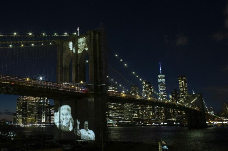 Black and white photos of Covid-19 victims are projected on to the Brooklyn Bridge as New York City marks more than 30,000 dead since the pandemic began