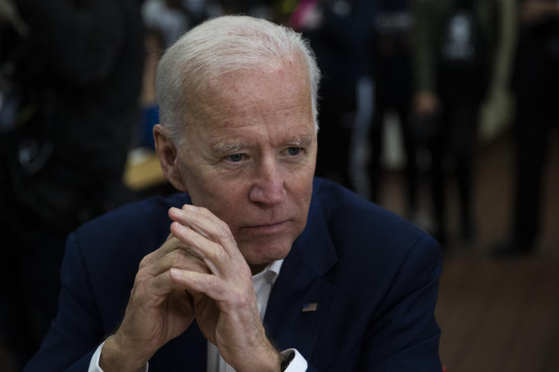 Former Vice President Joe Biden listens to voter in Los Angeles on Wednesday. The vice president is reportedly preparing a climate plan that he believes can appeal to blue-collar Trump voters. (ASSOCIATED PRESS/Jae C. Hong))