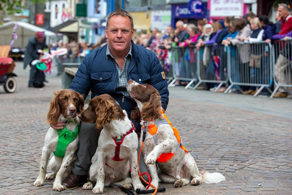 KESWICK, ENGLAND - JUNE 11:  Kerry Irving poses with his three dogs Max, Paddy, and Harry after he met Prince William, Duke of Cambridge and Catherine, Duchess of Cambridge as they visit Keswick Market place during a visit to Cumbria on June 11, 2019 in Keswick, England. The royal couple visited Keswick to join a celebration to recognise the contribution of individuals and local organisations in supporting communities and families across Cumbria. They then went on to visit a traditional fell sheep farm. (Photo by Andy Commins - WPA Pool/Getty Images)