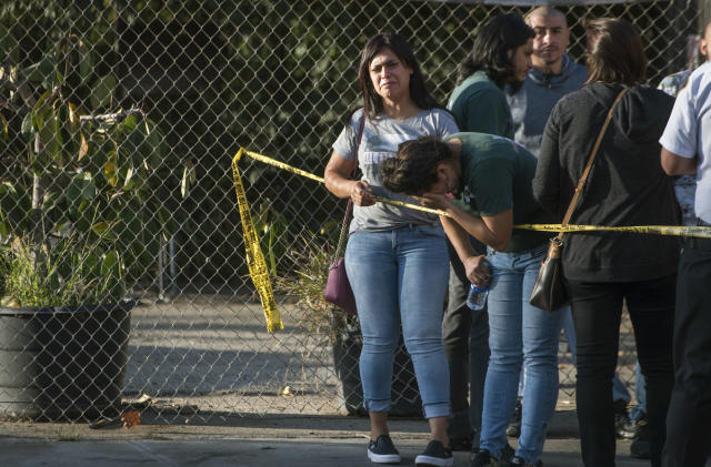 <p>A Trader Joe's employee weeps after hearing news that a woman was shot and killed inside the store in the Silverlake section of L.A. on Saturday. (Photo: Christian Monterosa via AP) </p>