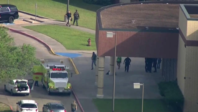 <p>In this image taken from video law enforcement officers respond to a high school near Houston after an active shooter was reported on campus, Friday, May 18, 2018, in Santa Fe, Texas. The Santa Fe school district issued an alert Friday morning saying Santa Fe High School has been placed on lockdown. (Photo: KTRK-TV ABC13 via AP) </p>