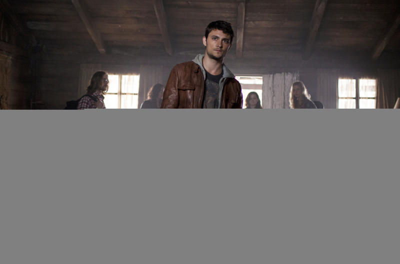 "This film image released by Sony-TriStar Pictures shows Shiloh Fernandez, center, in a scene from ""Evil Dead."" (AP Photo/ Sony-TriStar Pictures, Kirsty Griffin)"
