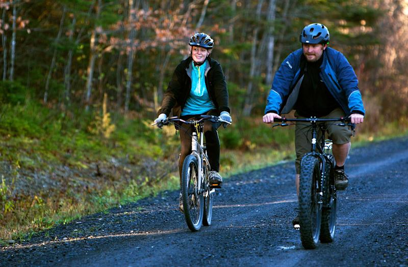 Kaci Hickox and boyfriend Ted Wilbur go for a bike ride in Fort Kent