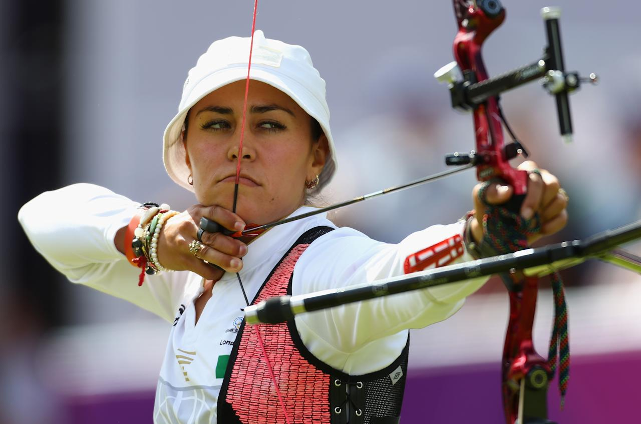 LONDON, ENGLAND - AUGUST 02:  Aida Roman Arroyo of Mexico competes in her Women's Individual Archery Semi Final match against Mariana Avitia Martinez of Mexico on Day 6 of the London 2012 Olympic Games at Lord's Cricket Ground on August 2, 2012 in London, England.  (Photo by Paul Gilham/Getty Images)