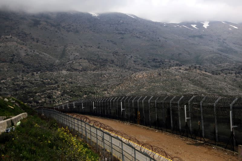 FILE PHOTO: Fences are seen on the ceasefire line between Israel and Syria in the Israeli-occupied Golan Heights