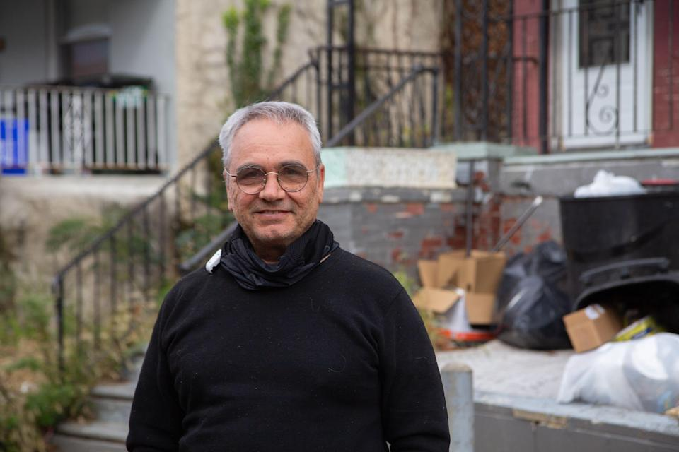 Moshe Attas,  in front of his property on Airdrie Street in Philadelphia. After COVID-19, Attas got involved in the city's eviction diversion program and worked out several agreements with tenants behind on their rent. (Kimberly Paynter/WHYY)