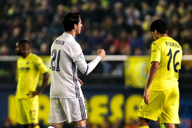 Alvaro Morata celebrates the winning goal after Real Madrid stage a comeback to beat Villareal 3-2 (AFP Photo/BIEL ALINO)