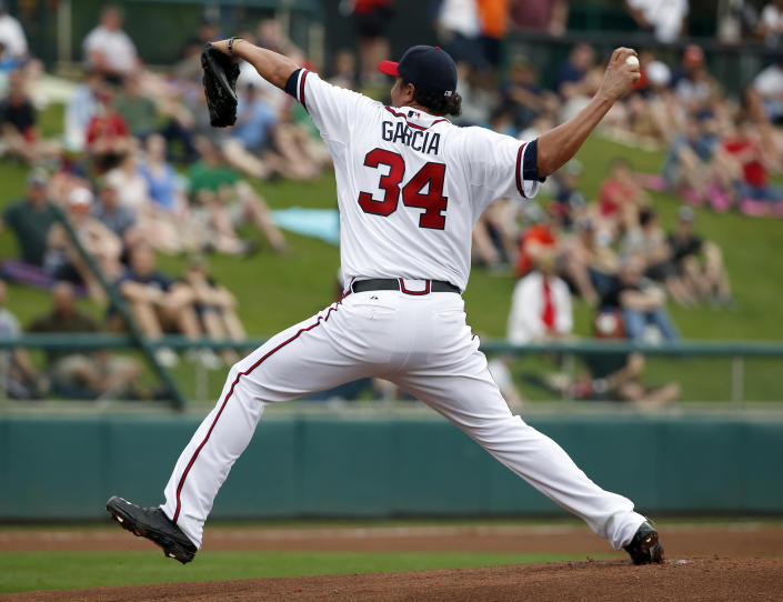 Atlanta Braves starting pitcher Freddy Garcia throws in the first inning of a spring exhibition baseball game against the Detroit Tigers, Wednesday, Feb. 26, 2014, in Kissimmee, Fla. (AP Photo/Alex Brandon)