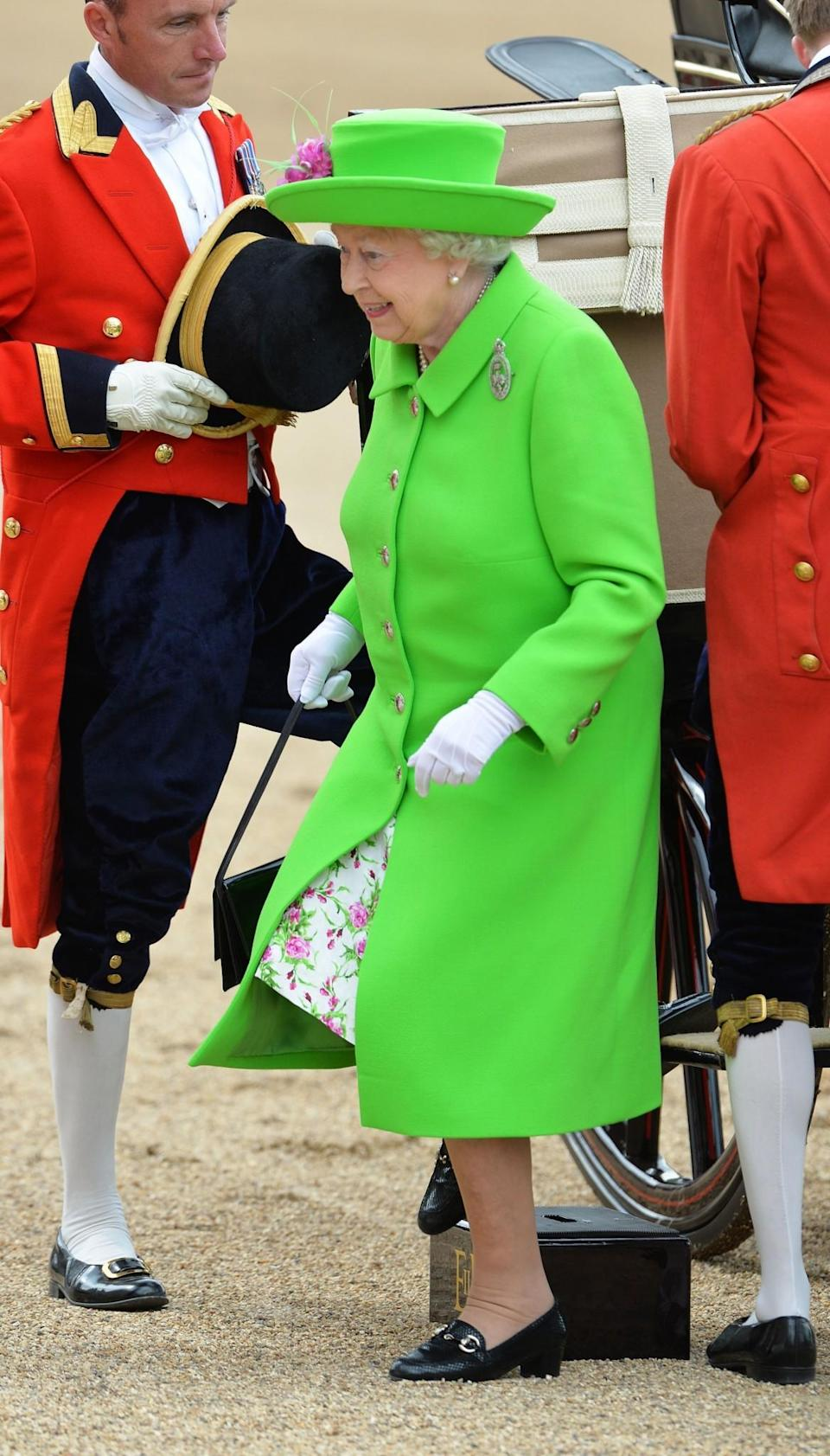 <p>No one can ever forget this lime green number worn on Her Majesty's 90th birthday/<br><i>[Photo: PA]</i> </p>