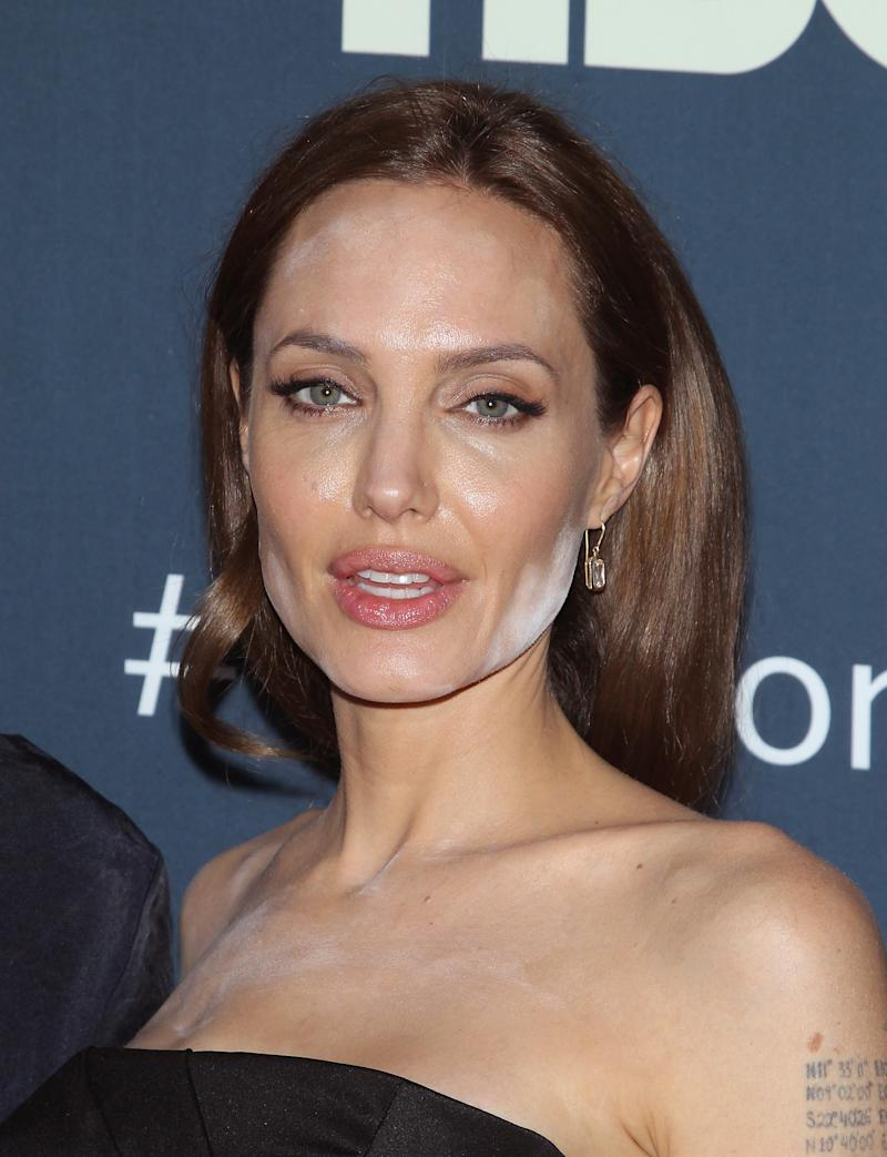 Angelina Jolie with white powder all over her face