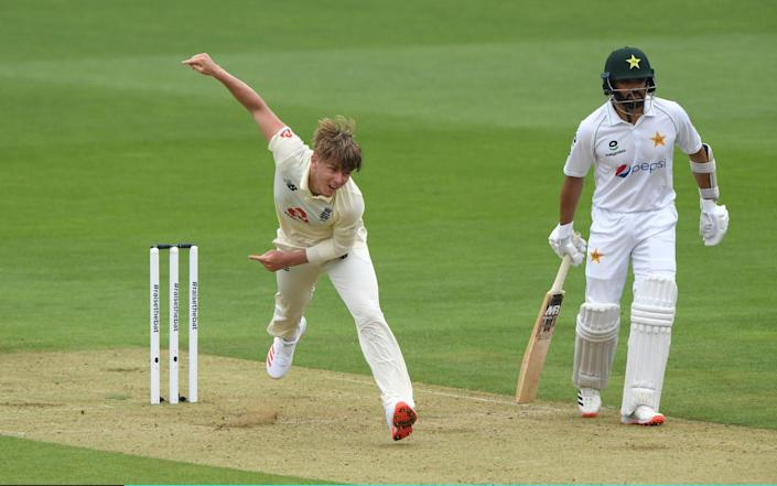 Sam Curran of England bowls watched on by Azhar Ali of Pakistan during Day One of the 2nd #RaiseTheBat Test Match between England and Pakistan at The Ageas Bowl on August 13, 2020 in Southampton, England - Getty Images Europe