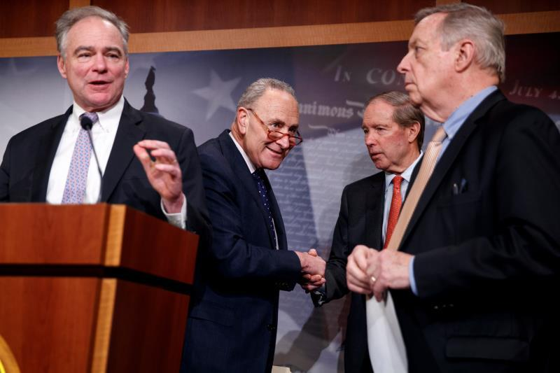 Senate Minority Leader Chuck Schumer (2-L) shakes with Democratic Senator from New Mexico Tom Udall (2-R), as Senate Democratic Whip Dick Durbin (R) listens to Democratic Senator from Virginia Tim Kaine (L) deliver remarks on the War Powers Resolution during a press conference in the US Capitol in Washington, DC, USA, 13 February 2020. EFE/EPA/SHAWN THEW