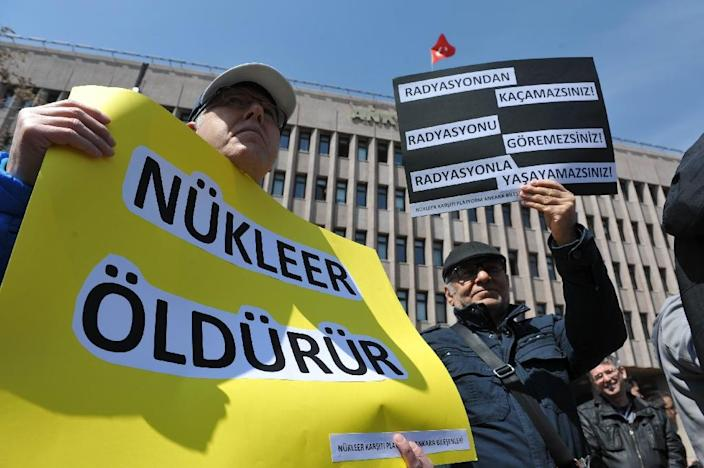 A Turkish environmental activist during a protest against Turkey's first nuclear power plant, in Ankara on April 14, 2015 (AFP Photo/Adem Altan)