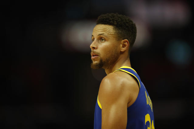 "In an article for The Players' Tribune, <a class=""link rapid-noclick-resp"" href=""/nba/teams/gsw/"" data-ylk=""slk:Golden State Warriors"">Golden State Warriors</a> guard <a class=""link rapid-noclick-resp"" href=""/nba/players/4612/"" data-ylk=""slk:Stephen Curry"">Stephen Curry</a> opened up about various topics, including President Donald Trump, athlete protests and respecting veterans. (AP)"