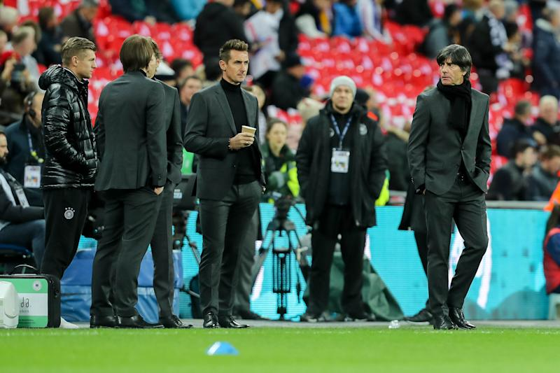 LONDON, ENGLAND - NOVEMBER 10: Toni Kroos of Germany Assistant coach Thomas Schneider of Germany Assistant coach Marcus Sorg of Germany Miroslav Klose, Head hoach Joachim Loew of Germany looks on during the international friendly match between England and Germany at Wembley Stadium on November 10, 2017 in London, United Kingdom. (Photo by TF-Images/TF-Images via Getty Images)