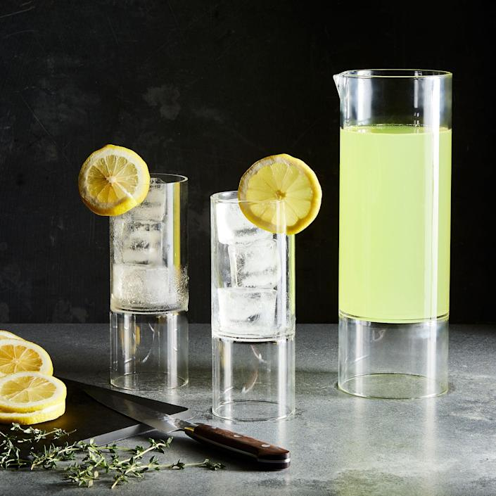 """Handmade in the Czech Republic, the Revolution pitcher is dishwasher-safe and designed with an exaggerated glass base to make your beverages look like they're floating on air. $180, Food52. <a href=""""https://food52.com/shop/products/5165-revolution-carafe"""" rel=""""nofollow noopener"""" target=""""_blank"""" data-ylk=""""slk:Get it now!"""" class=""""link rapid-noclick-resp"""">Get it now!</a>"""