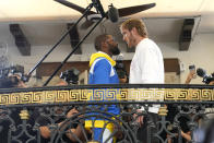 Floyd Mayweather, left, and and Logan Paul, right, face off during a press event, Thursday, June 3, 2021, in Miami Beach, Fla. Mayweather will fight Paul in an exhibition boxing match at the Hard Rock Stadium in Miami Gardens, Fla. Sunday. (AP Photo/Lynne Sladky)