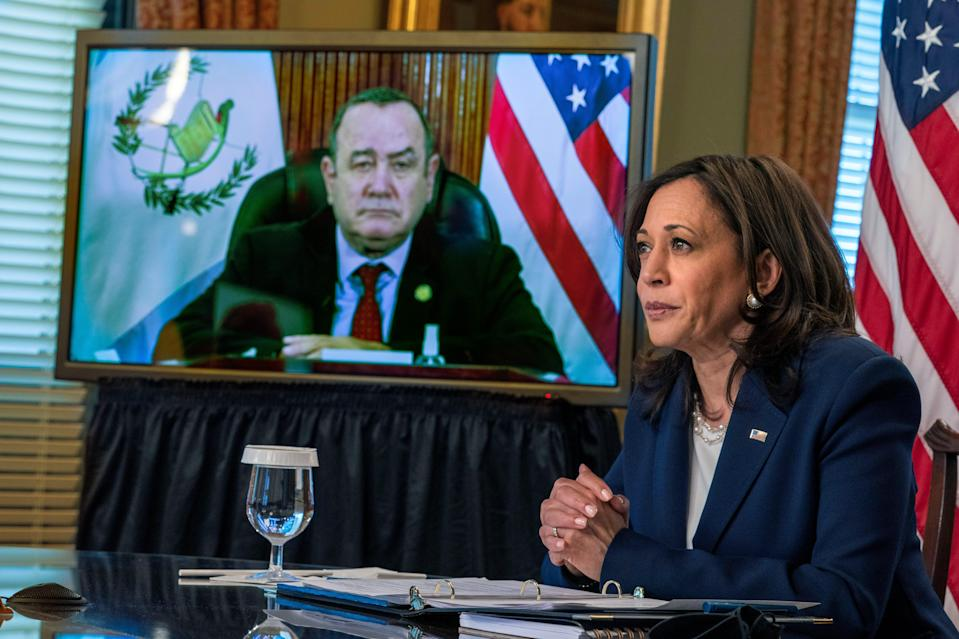 Vice President Kamala Harrismeets virtually with Guatemala's President Alejandro Giammattei, seen on screen at left, Monday, April 26, 2021, from her ceremonial office at the Eisenhower Executive Office Building on the White House complex in Washington.