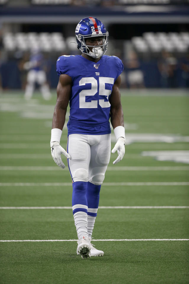 FILE - In this Sunday, Sept. 8, 2019 file photo, New York Giants defensive back Corey Ballentine (25) warms up before a NFL football game against the Dallas Cowboys in Arlington, Texas. A day after making his NFL debut with the New York Giants, Ballentine testified at a preliminary hearing about the day his best friend and former Washburn University teammate Dwane Simmons was shot to death. (AP Photo/Ron Jenkins, File)