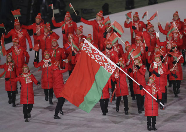 <p>Alla Tsuper carries the flag of Belarus during the opening ceremony of the 2018 Winter Olympics in Pyeongchang, South Korea, Friday, Feb. 9, 2018. (AP Photo/Michael Sohn) </p>