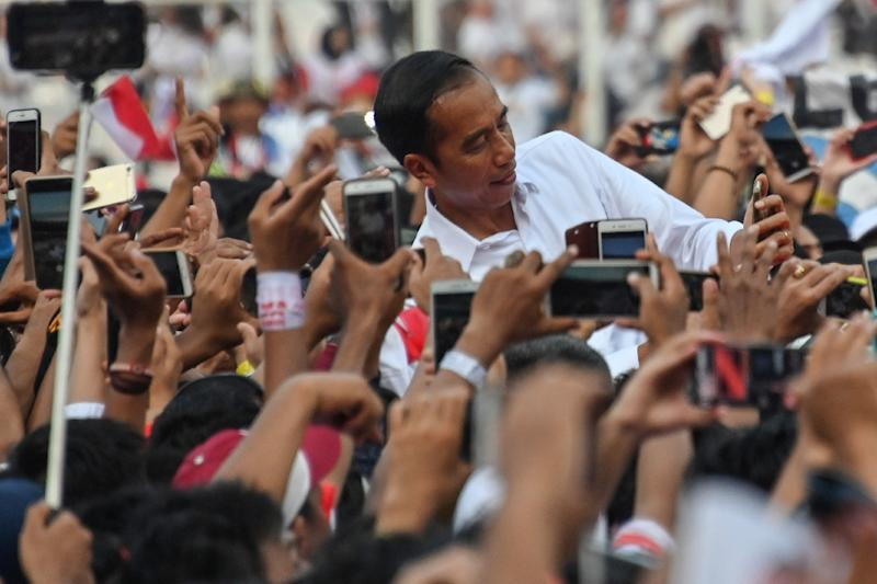 The election is largely a referendum on President Joko Widodo's infrastructure-driven bid to rev up Southeast Asia's largest economy (AFP Photo/BAY ISMOYO)