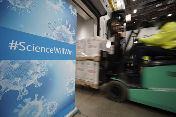 FILE - In this Dec. 13, 2020, file photo, boxes containing the Pfizer-BioNTech COVID-19 vaccine are loaded onto a truck for shipping at the Pfizer Global Supply Kalamazoo manufacturing plant in Portage, Mich. As the world struggles to break the grip of COVID-19, psychologists and misinformation experts are studying why the pandemic spawned so many conspiracy theories, which have led people to eschew masks, social distancing and vaccines. (AP Photo/Morry Gash, Pool, File)