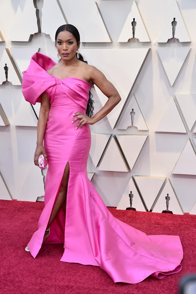 <p>At age 60, Angela's hot pink fitted gown is everything. </p>