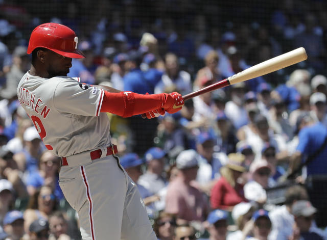 FILE - In this May 23, 2019, file photo, Philadelphia Phillies' Andrew McCutchen hits a double against the Chicago Cubs during the first inning of a baseball game in Chicago. McCutchen says he plans to be ready for opening day after a knee injury cut short his 2019 season. (AP Photo/Nam Y. Huh, File)