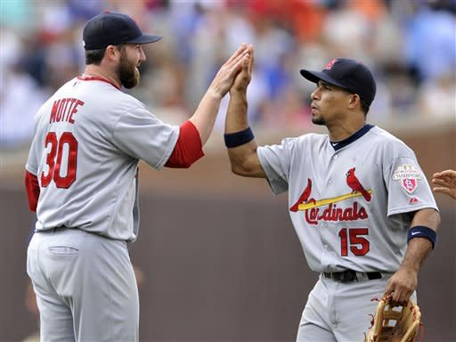 St. Louis Cardinals closing pitcher Jason Motte, left, celebrates with teammate Rafael Furcal after defeating the Chicago Cubs 9-6 during a baseball game in Chicago, Friday, July 27, 2012. (AP Photo/Paul Beaty)