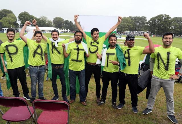 Pakistan supporters pose as wind and rain cancels play during the second one day international cricket match between Ireland and Pakistan at the Malahide stadium in Dublin on August 20, 2016 (AFP Photo/Paul Faith)