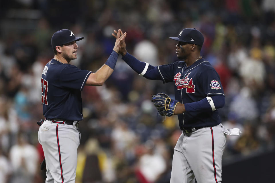Atlanta Braves' Jorge Soler, right, celebrates with Austin Riley after they defeated the San Diego Padres in a baseball game Saturday, Sept. 25, 2021, in San Diego. (AP Photo/Derrick Tuskan)