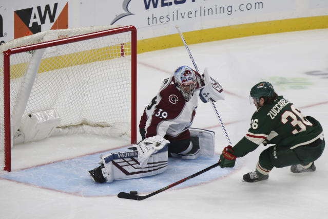Minnesota Wild's Mats Zuccarello lines up a shot against Colorado Avalanche's goalie Pavel Francouz in the third period of an NHL preseason hockey game Saturday, Sept. 21, 2019, in St. Paul, Minn. (AP Photo/Stacy Bengs)