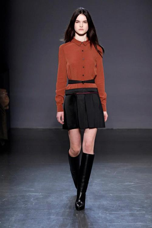 Flattering blouse cuts and pleated skirts were a feature, including this burnt orange shade moving the netural palette forward.<br><br>©Facebook/Victoria Beckham