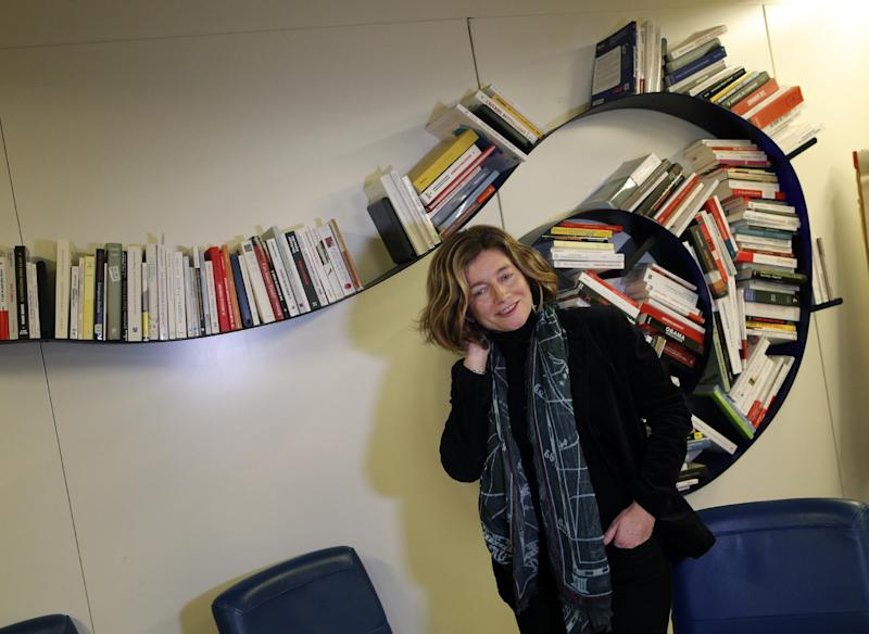 "In this photo taken Tuesday, Nov. 12, 2013, chief editor of Le Monde newspaper Natalie Nougayrede, arrives for an interview with The Associated Press, in Paris. As revelations about the staggering scope of the NSA's surveillance have cascaded around the world, newsroom leaders weighed ethical decisions over how much they should reveal about intelligence. Nougayrede said the paper has not come under pressure from French authorities to turn over documents or withhold information but is keeping the documents it obtained ""in a safe place"" that she would not describe.(AP Photo/Christophe Ena)"