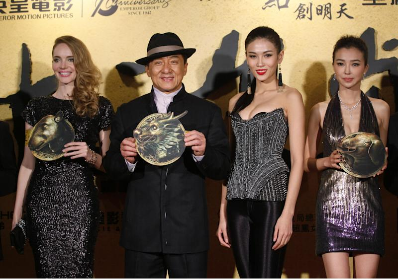 "From left, French actress Laure Weissbecker, Hong Kong movie star Jackie Chan, Chinese actresses Zhang Lanxin and Yao Xingtong pose for photographers during the charity premiere of his new movie ""CZ12"" in Hong Kong, Thursday Dec. 13, 2012. Jackie Chan suggests in a recent interview that protests should be restricted in the freewheeling Chinese city of Hong Kong. The action star lamented that Hong Kong has become a city of protest, where people ""scold China, scold the leaders, scold anything, protest against anything."" (AP Photo/Kin Cheung)"