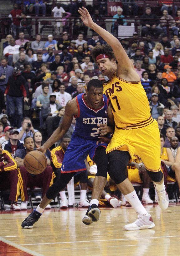 Philadelphia 76ers' Thaddeus Young, left, drives the baseline against Cleveland Cavaliers' Anderson Varejao, of Brazil, during the second quarter of an NBA preseason basketball game Monday, Oct. 21, 2013, in Columbus, Ohio. (AP Photo/Jay LaPrete)