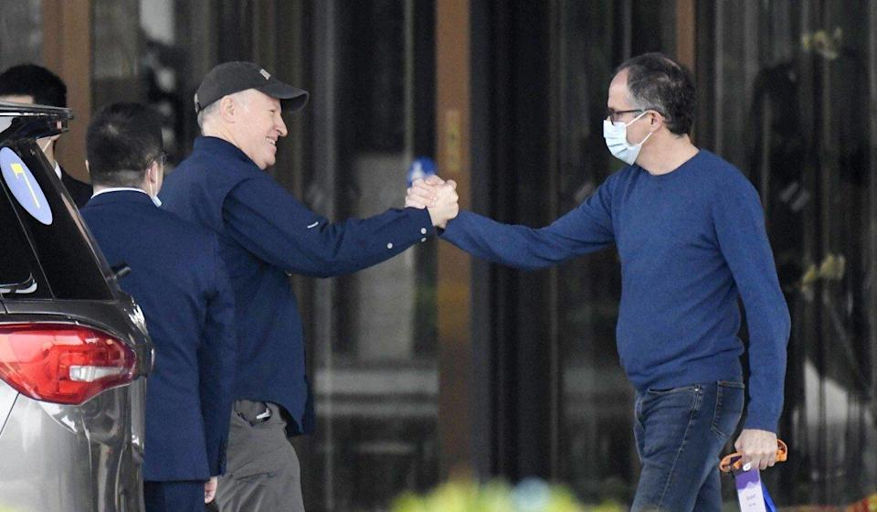 Peter Daszak (left) and Peter Ben Embarek of a World Health Organization team shake hands before leaving their hotel for the airport at the end of their mission to investigate the origins of the coronavirus pandemic in Wuhan on Wednesday. Photo: Kyodo