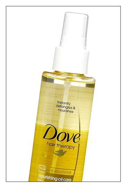 """<div class=""""caption-credit""""> Photo by: TotalBeauty.com</div><div class=""""caption-title"""">Dove Nourishing Oil Care Detangler, $5.99</div>This blend of argan and almond oils is super light. While it's touted as a detangler, you can also use it as a leave-in conditioner, shine spray, and frizz serum. Shake the bottle to blend the two oils, and mist. We especially love this one for finishing a sleek ponytail."""