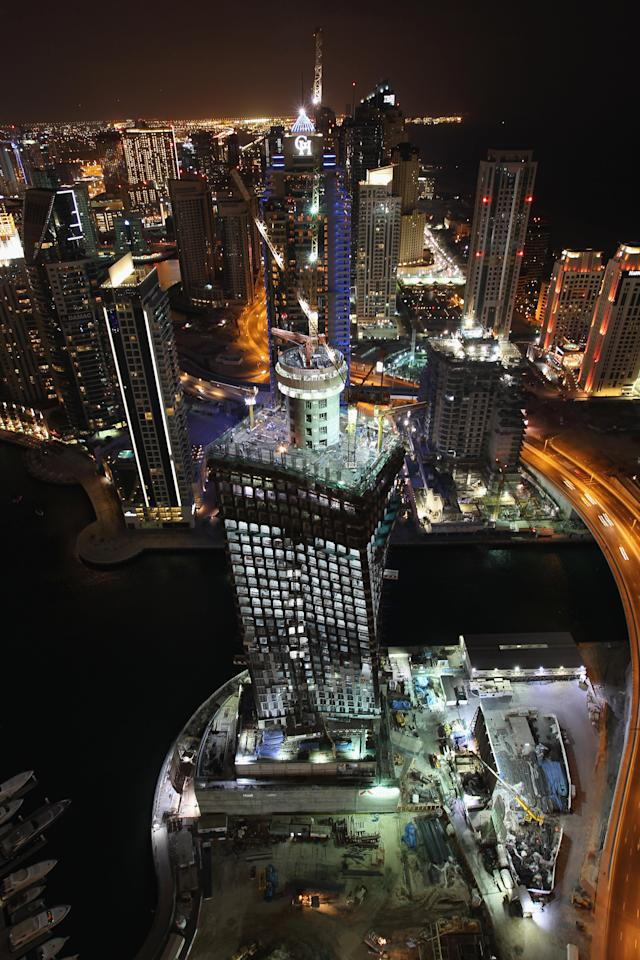 DUBAI, UNITED ARAB EMIRATES - DECEMBER 03: A general view of the Dubai Marina at night on December 3, 2009 in Dubai, United Arab Emirates. Stock markets in the Dubai and Abu Dhabi fell sharply this week after state owned company Dubai World asked for more time to pay off depts, amounting to 35Bn GBP. The Dubai economy which has enjoyed years of rapid growth has seen a sharp decline recently as world markets reacted to the global economic crisis. (Photo by David Rogers/Getty Images)