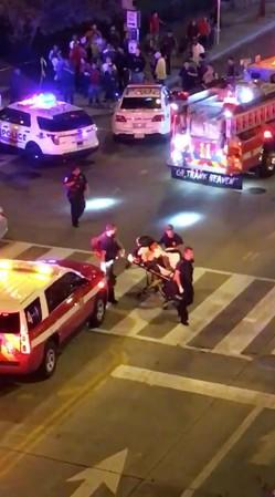 A person is wheeled out on a stretcher following a shooting in Washington
