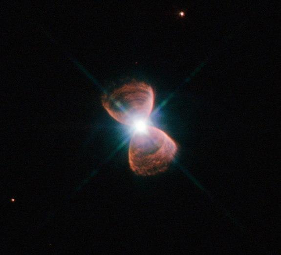 This image taken with the NASA/ESA Hubble Space Telescope shows an example of a bipolar planetary nebula. This object, which is known as Hubble 12 and also catalogued as PN G111.8-02.8, lies in the constellation of Cassiopeia.